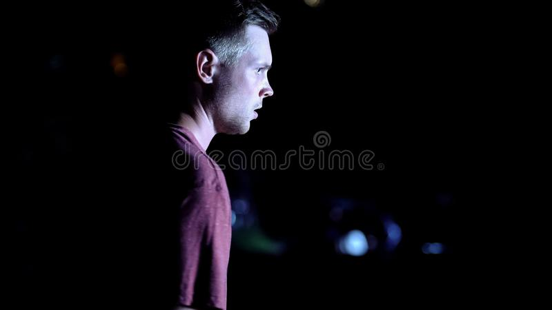 Male witness shocked by terrible accident he saw, fatal outcome late at night. Stock photo royalty free stock photo