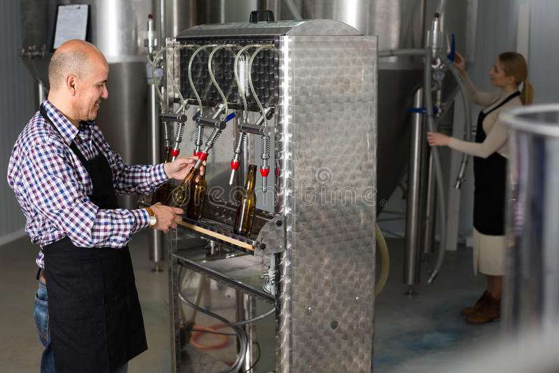 Male worker on beer brewery stock photo