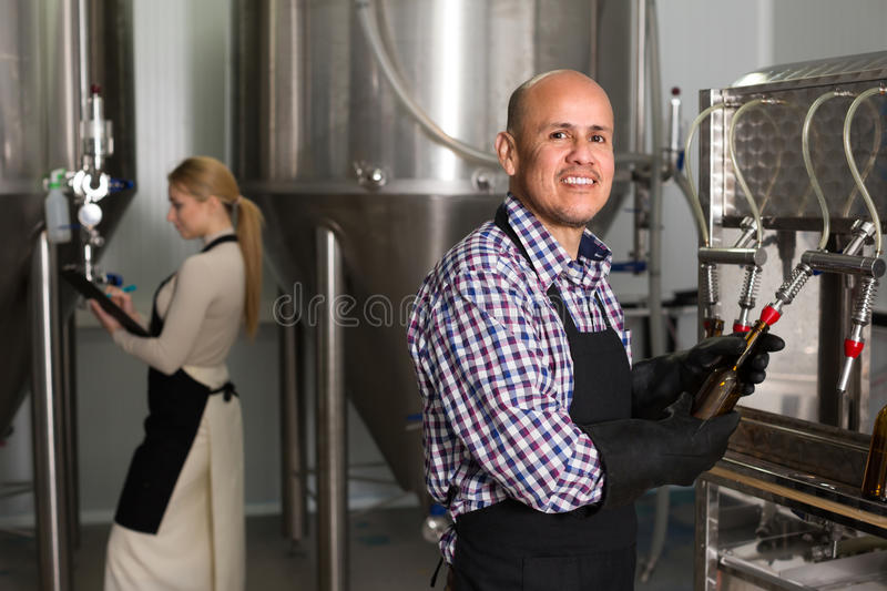 Male worker on beer brewery royalty free stock photo