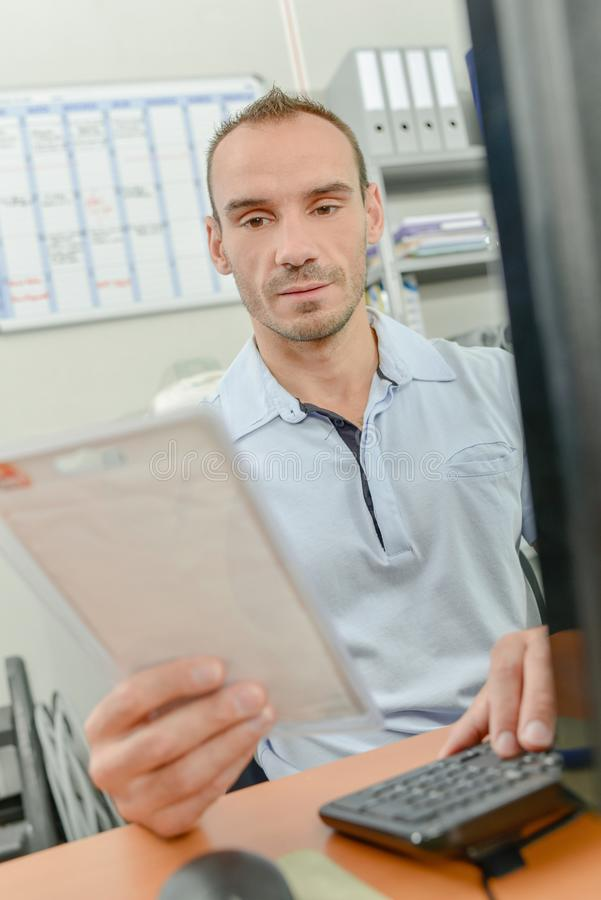Male worker checking stock royalty free stock photos