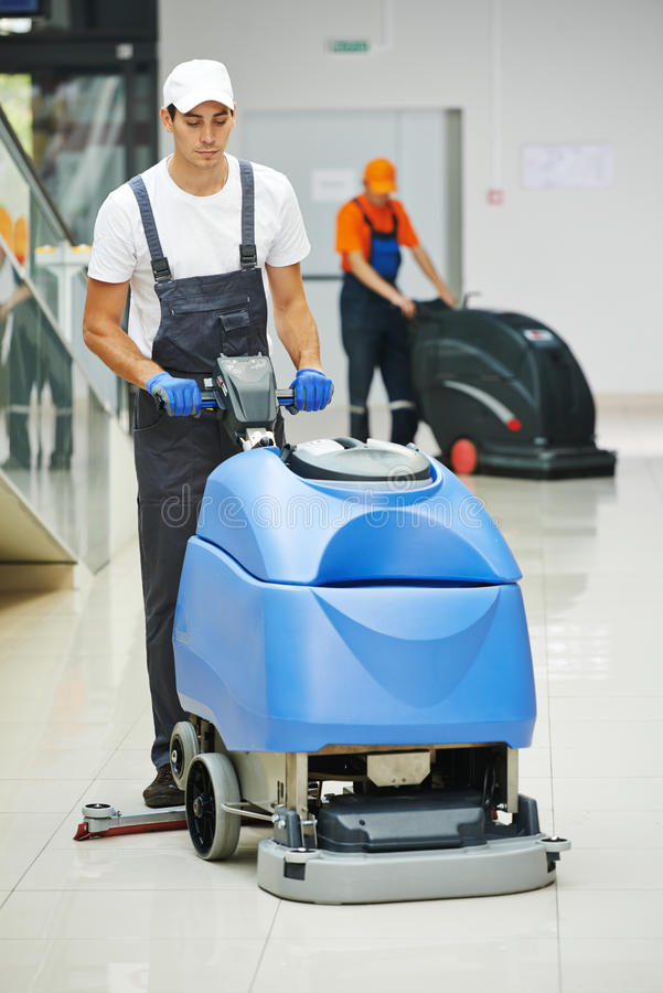 Male worker cleaning business hall royalty free stock photo