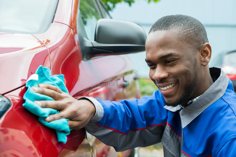 Male Worker Cleaning Car stock photography