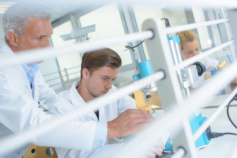 Male worker at dental laboratory stock photo