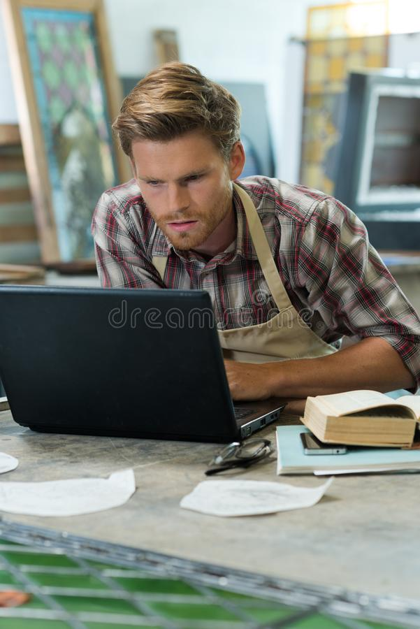 Male worker with laptop working online royalty free stock photos
