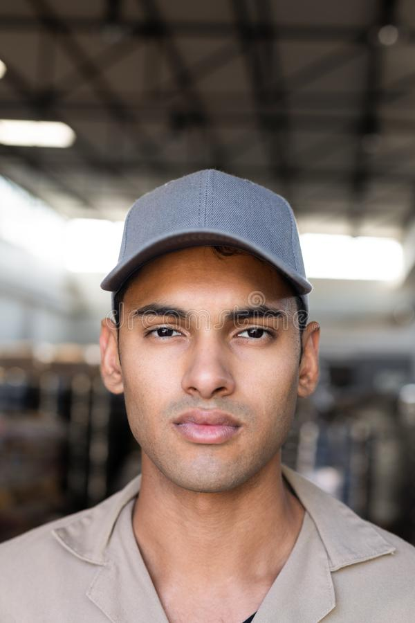 Male worker looking at camera in warehouse. Close-up of male worker looking at camera in warehouse. This is a freight transportation and distribution warehouse royalty free stock images