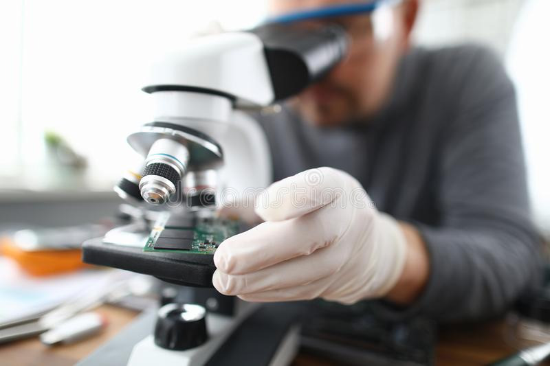 Male worker pc repair service in white protective royalty free stock photo