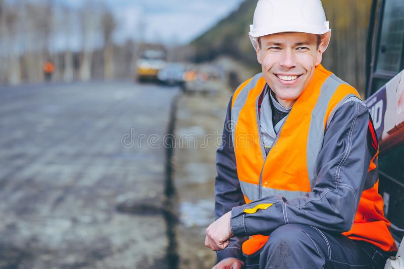 Male worker road construction. Infrastructure repair pavement stock images