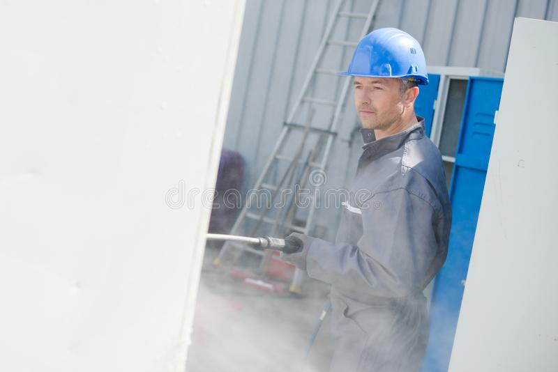 Male worker during termite control stock image
