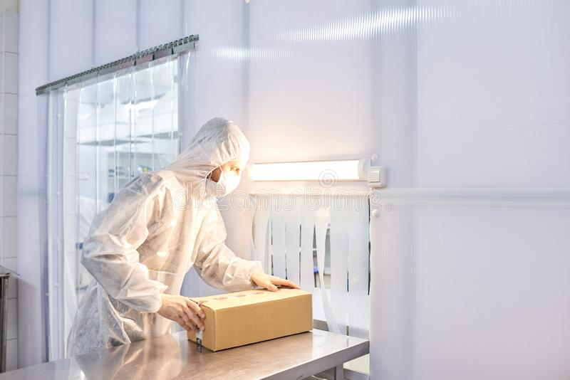 Worker Packing Medicinal Products royalty free stock photography