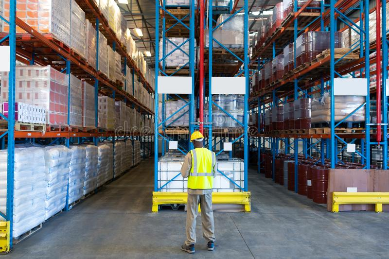 Male worker working in warehouse stock photography