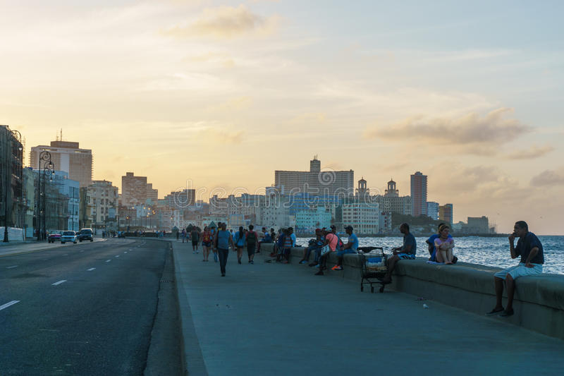 Malecon view, people and buildings in sunset royalty free stock images