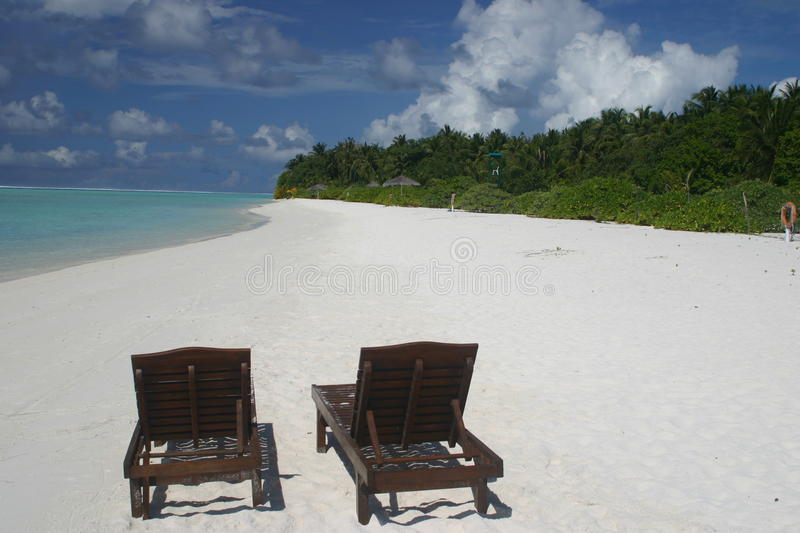 Maledives Beach Lounges stock images