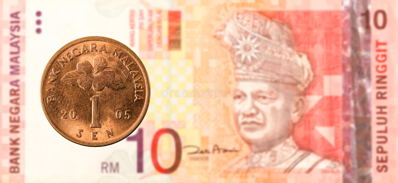 1 Maleis sen-muntstuk tegen Maleis ringgit 10 bankbiljet royalty-vrije stock fotografie