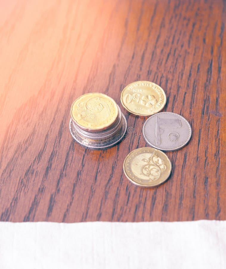 Maleise ringgit muntstukken stock afbeeldingen