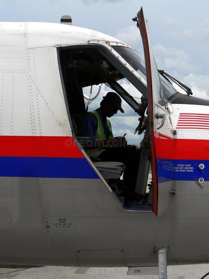 Maleisië. Ingenieur in Cockpit stock afbeeldingen