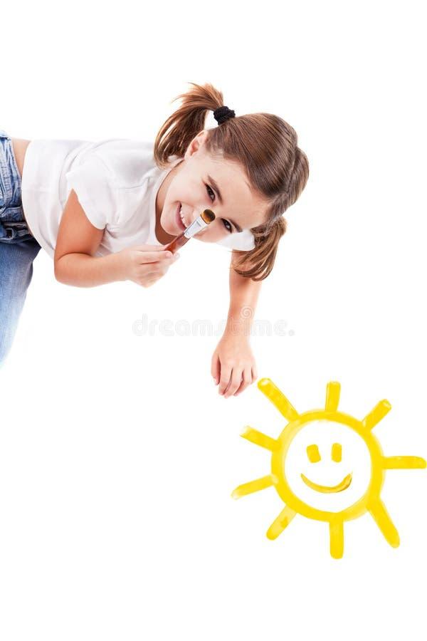 Malen einer glücklichen Sonne lizenzfreie stockfotografie