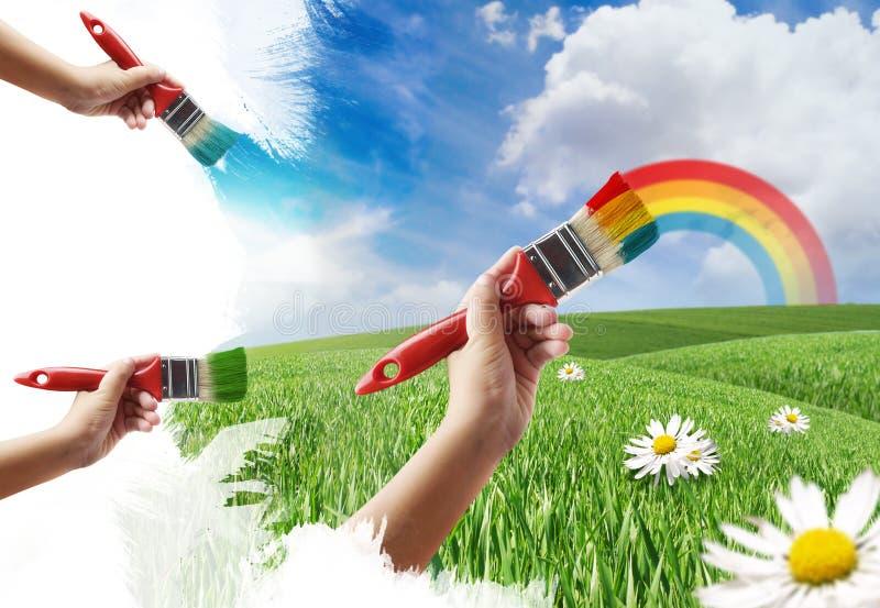 Malen einer Wiese und des Regenbogens lizenzfreie stockfotografie