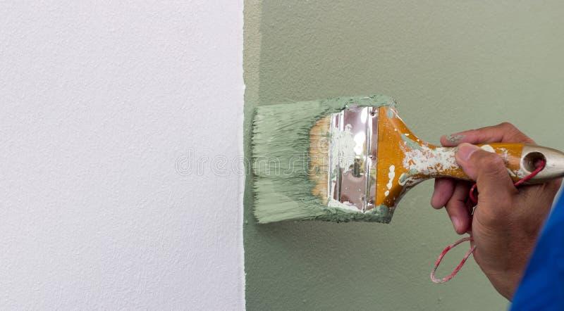 Malen Sie bruch Farbe auf Wand stockfoto