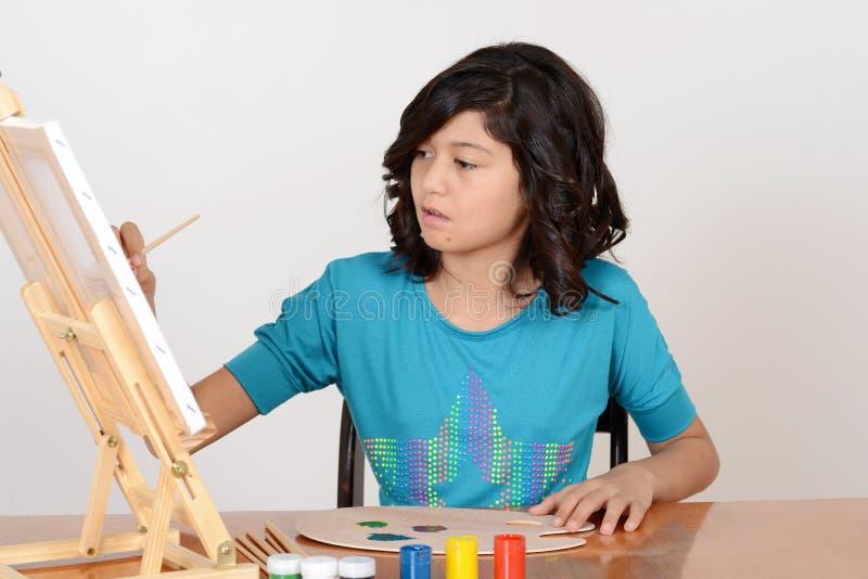 Malerei des jungen Mädchens stockfoto
