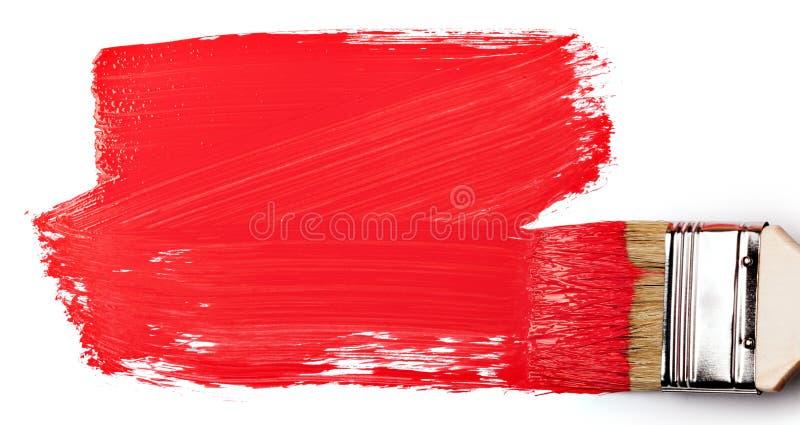 Malerpinsel mit rotem Lack stockfotografie