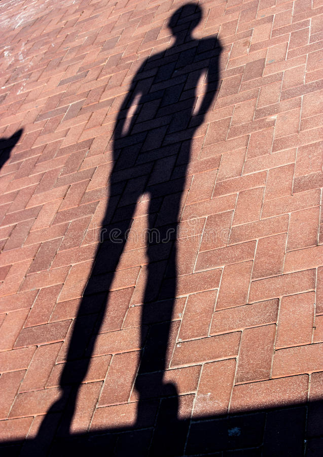 Males shadow. Cast in Barcelona sunshine royalty free stock photos