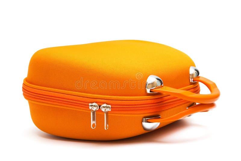 Maleta anaranjada imagenes de archivo