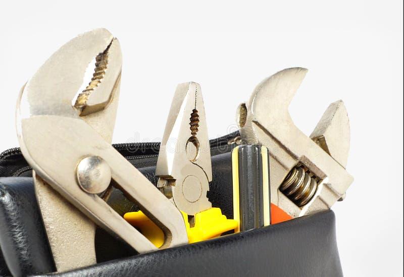 Maleta de ferramentas com isolado no fundo cinzento Jogo de ferramenta Caixa de ferramentas fotos de stock