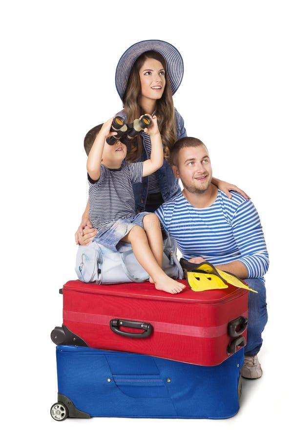 Maleta del viaje de la familia, padre Mother y en el equipaje, sobre blanco foto de archivo