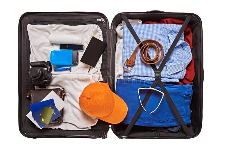 Maleta llena para viajar del hombre imágenes de archivo libres de regalías