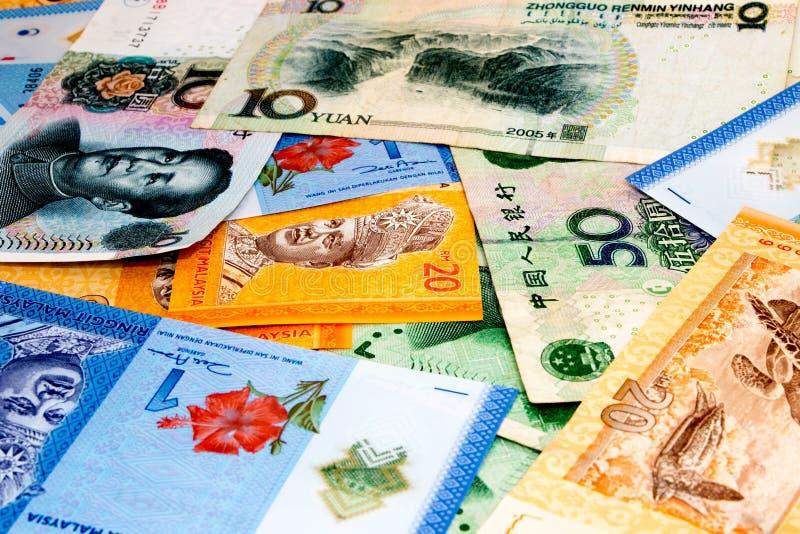 Malezja waluta VS Chiny waluta zdjęcia royalty free