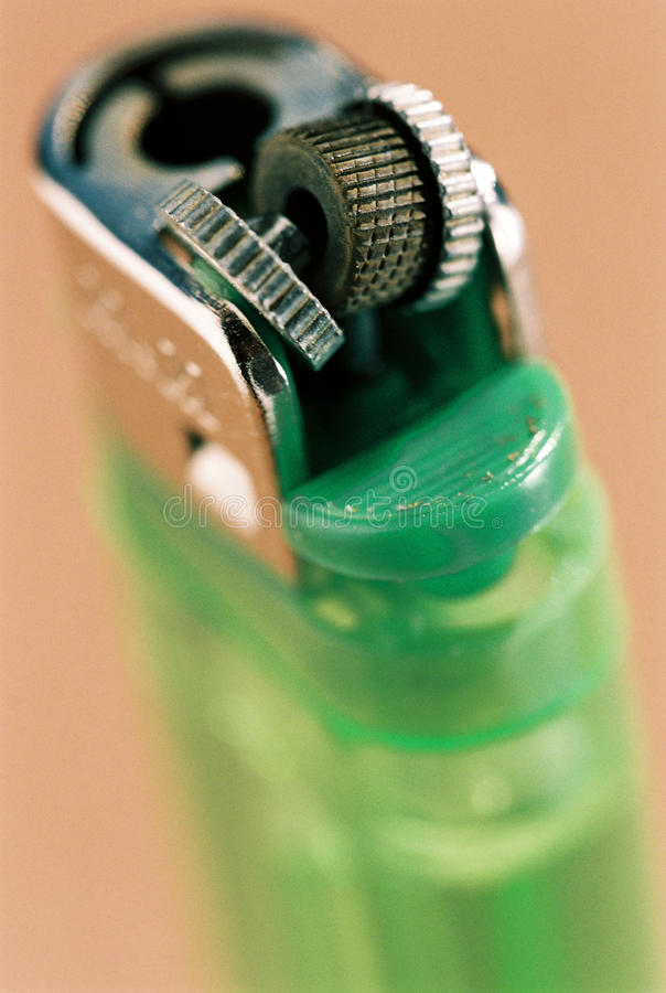 Malfunctioning Green Used Lighter Royalty Free Stock Photography