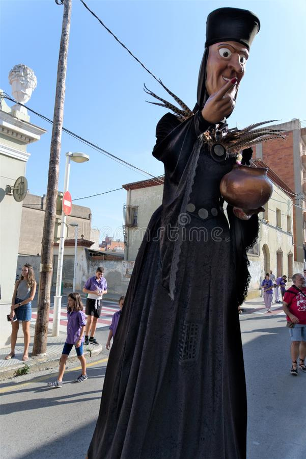 Malgrat de Mar, Catalonia, Spain, August 2018. Fairytale witch with a bronze pot on a city street. royalty free stock image