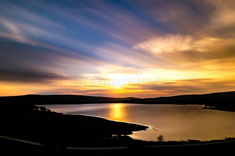 Malham Tarn in the Yorkshire Dales, England. Sunset on a summer`s evening on Malham Tarn in the Yorkshire Dales, England stock image