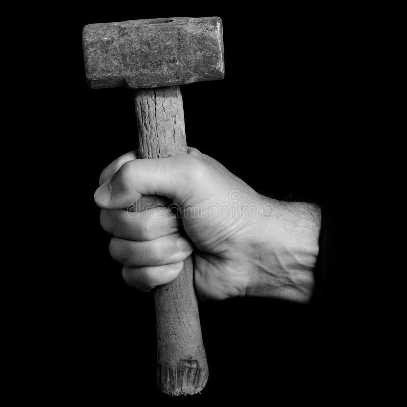 malho - ferramentas em uma mão do ` s do homem foto de stock royalty free