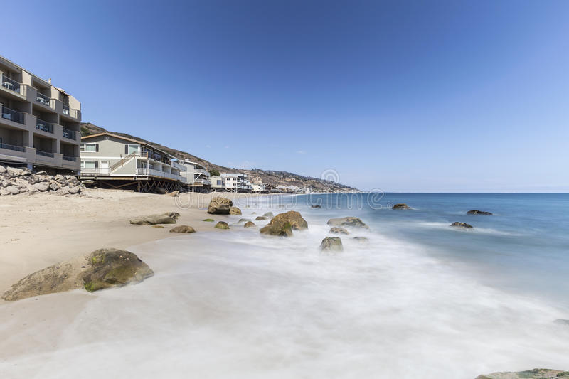 Malibu Beach Homes with Motion Blur Surf. Near Los Angeles in Southern California royalty free stock photo