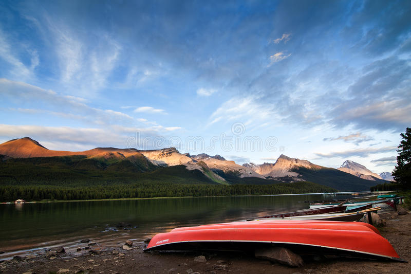 Maligne Lake at Sunset - red boats in Jasper NP, Canada royalty free stock photos