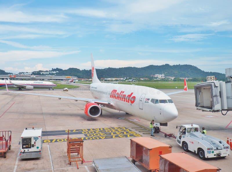 Malindo空气登陆在槟城国际机场,马来西亚 免版税图库摄影