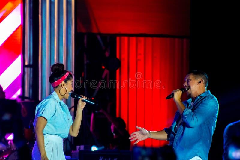 Maliq & D`Essentials Band - Looking each other. Rivani Indriya Suwendi L and Angga Puradiredja performed onstage during the Soundrenaline 2017 at Lanud Soewondo royalty free stock photo