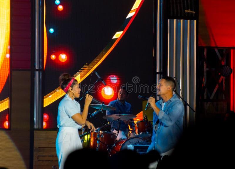 Maliq & D`Essentials Band - Looking each other. Rivani Indriya Suwendi L and Angga Puradiredja performed onstage during the Soundrenaline 2017 at Lanud Soewondo royalty free stock images