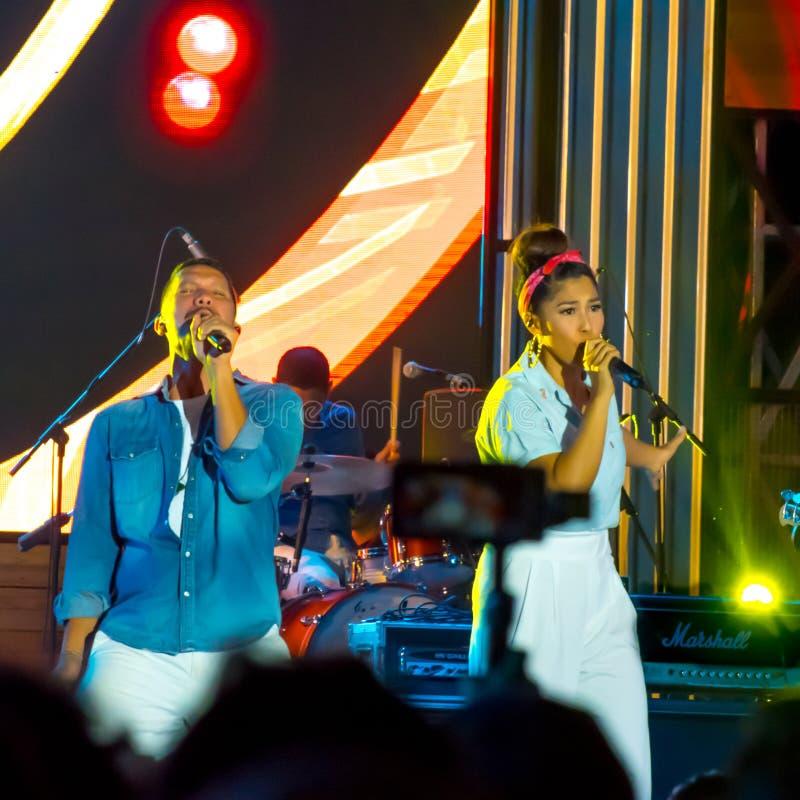 Maliq & D`Essentials Band - Recording audiences. Angga Puradiredja L and Rivani Indriya Suwendi, vocalists band from Maliq & D`Essentials performed onstage stock image