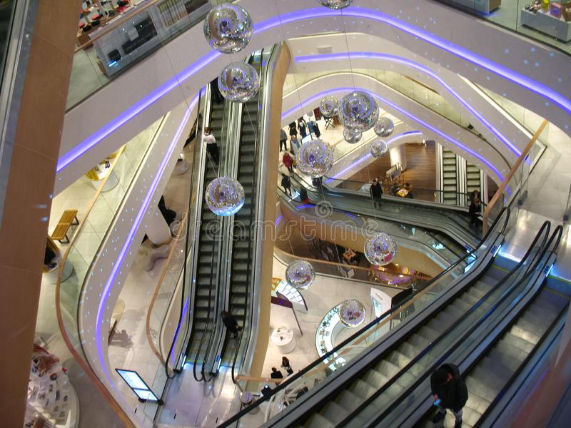 Mall Escalators, Decorating disco balls. People are rise uo, down, mall in Kiev, Ukraine stock images