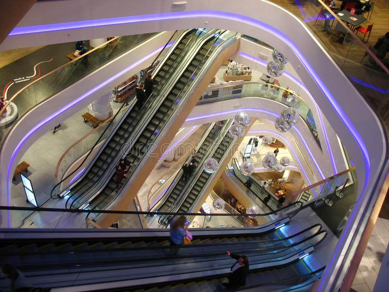 Mall Escalators in Kiev, Shopping mall. Mall Escalators, Decorating disco balls, people are rise uo, down, mall in Kiev, Ukraine royalty free stock image