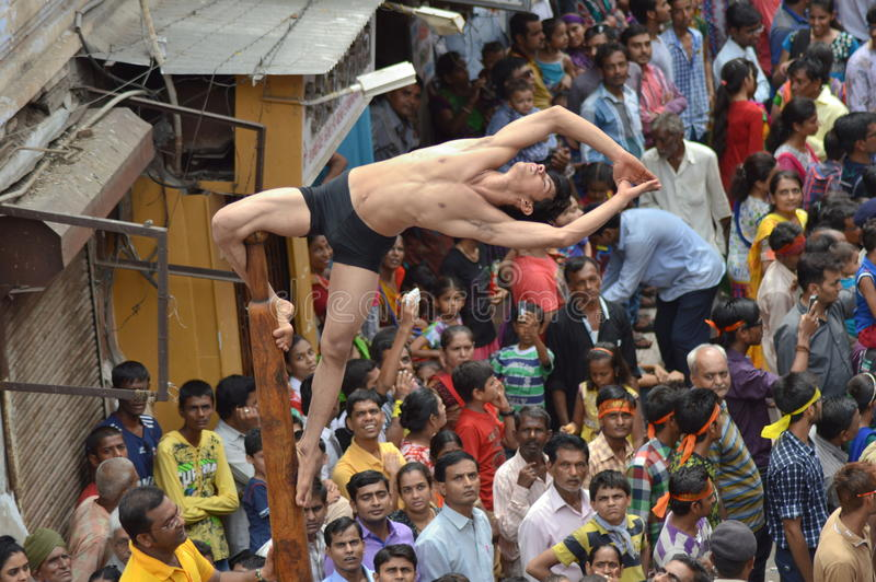 Mallakhamba ( Indian Gymnastics) performance on street. Mallakhamba or Malkhamb is ancient form of Indian Gymnastics, and traditional Indian sport in which a stock photos