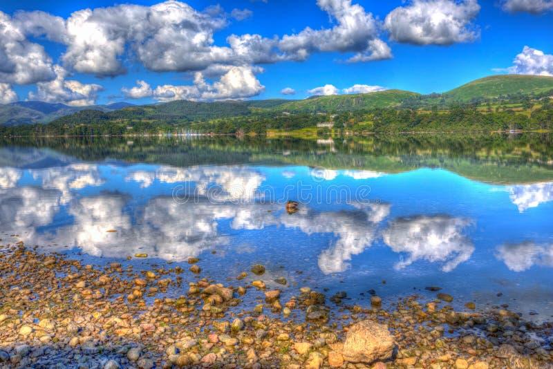 Mallard duck Lake District Cumbria England UK Ullswater water like glass hdr. Mallard duck Lake District Cumbria England UK Ullswater with mountains and blue sky stock photo