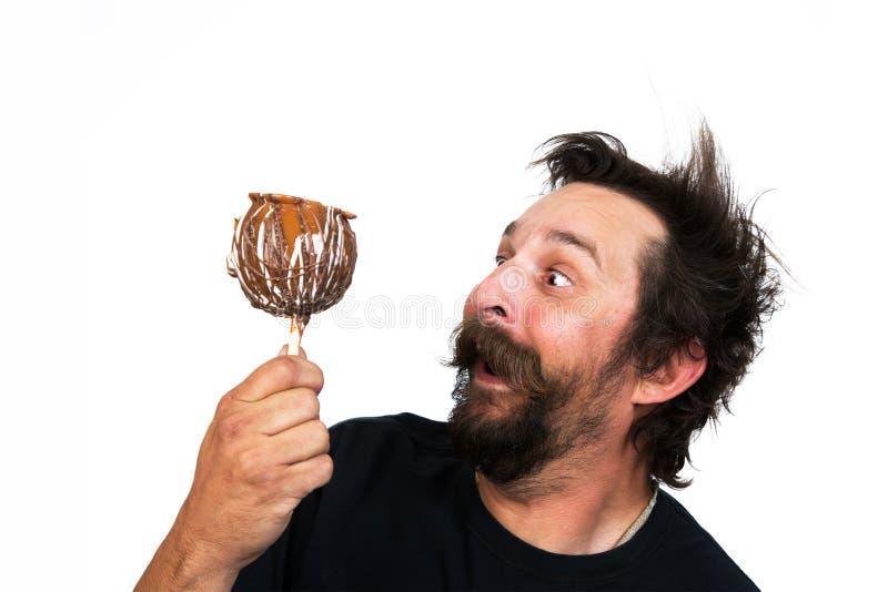 Malle mens met suikergoedappel royalty-vrije stock foto's