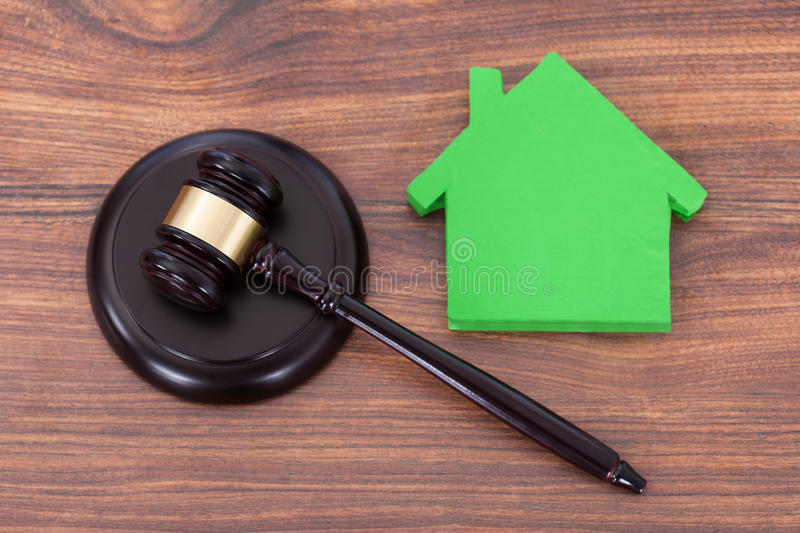 Mallet on block by green house model royalty free stock photos