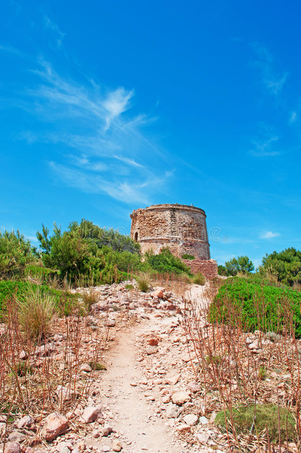 Mallorca, Majorca, Balearic Islands, Spain, tower, watch tower, fort, castle, Mediterranean, dirt road, maquis, footpath. View of Mediterranean maquis and Torre royalty free stock image