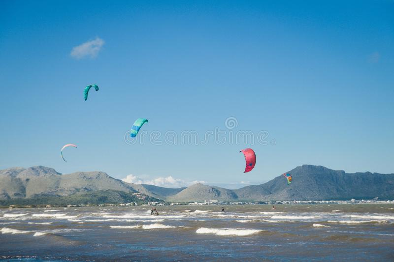 Mallorca, Spain - November 12, 2018: Kiteboarding. Entertainment in sea waves, Extreme sports Kitesurfing. Recreational activities, water sports, action royalty free stock photography