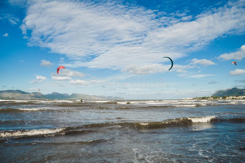 Mallorca, Spain - November 12, 2018: Kiteboarding. Mallorca, Spain - October 12, 2018: Kiteboarding. Entertainment in sea waves, Extreme sports Kitesurfing stock image