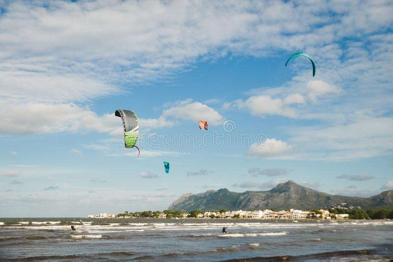 Mallorca, Spain - November 12, 2018: Kiteboarding. Mallorca, Spain - October 12, 2018: Kiteboarding. Entertainment in sea waves, Extreme sports Kitesurfing royalty free stock photos